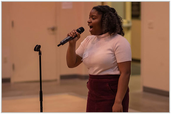 Amari Lewis performing at a VLS dinner