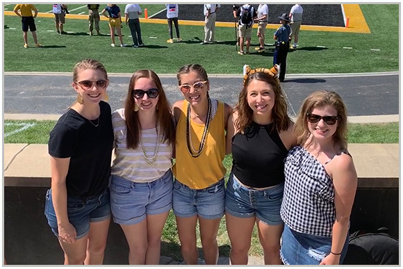 Madison at a MU football game with friends